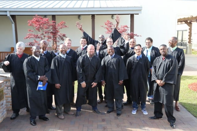 Photo of a group of men celebrating their graduation from Waterfront Rescue Mission's addiction recovery program