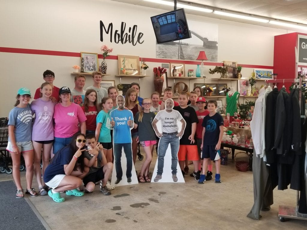 Photo of a church group volunteering at a Waterfront Thrift Store