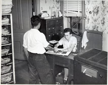 Overnight guests checking into historic Waterfront Rescue Mission shelter in the 1950's, previously located in downtown Pensacola.
