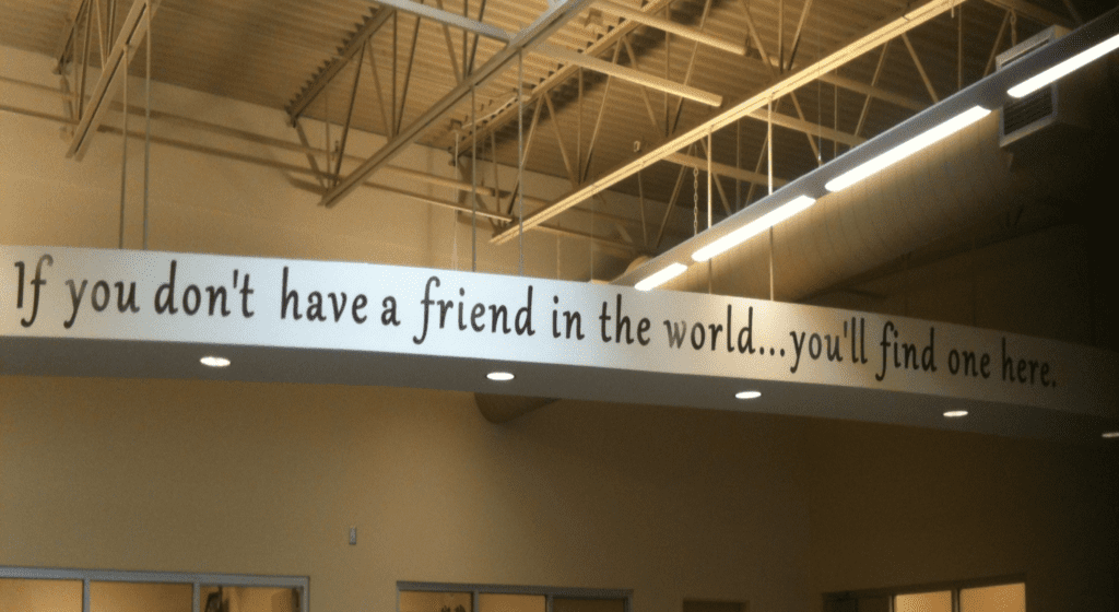 """Photo of the inside of Waterfront Rescue Mission's Pensacola campus with a sign that reads: """"If you don't have a friend in the world...you'll find one here."""""""