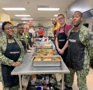 Photo of a group of military personnel volunteering at Waterfront Rescue Mission