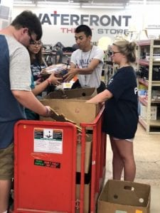 Photo of young students volunteering at Waterfront Rescue Mission