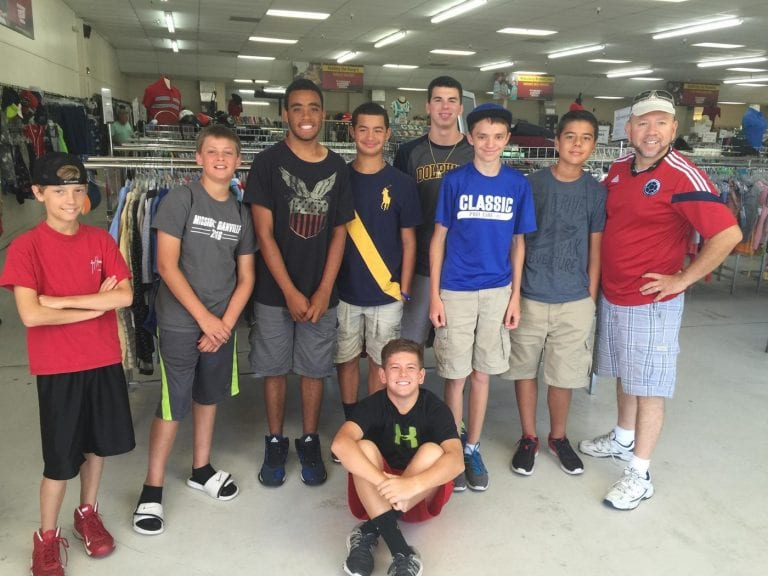 Photo of a group of young boys volunteering at Waterfront Thrift Stores
